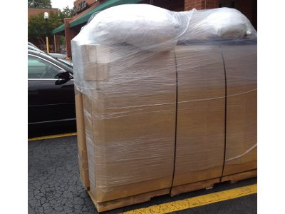 Packed king size mattress and bed on shipping pallet